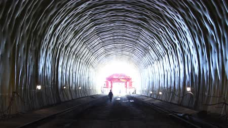 underground tunnel : A tunnel with a bright light at the end.