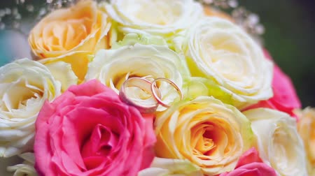 bouquets : Bright bridal bouquet of roses with wedding rings