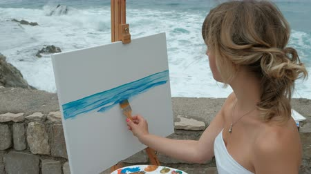 taslakkitabım : Young artist on the shore of the surging waves in writing seascape