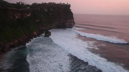sunset sea : Sunset at the Uluwatu Temple over the Indian Ocean at Bali