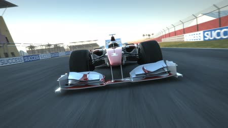 гонка : Formula One race car speeding along home stretch and past tilted camera