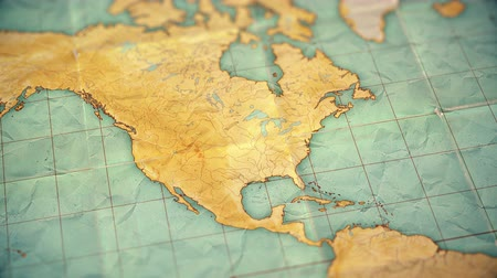 sepia : Zoom in from World Map to North America. Old well used world map with crumpled paper and distressed folds. Vintage sepia colors. Blank version