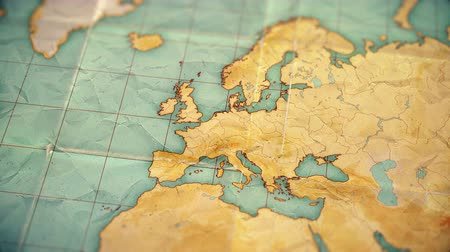 szépia : Zoom in from World Map to Europe. Old well used world map with crumpled paper and distressed folds. Vintage sepia colors. Blank version Stock mozgókép