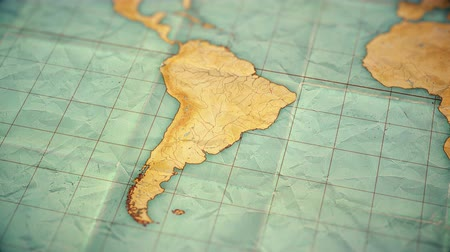 sepia : Zoom in from World Map to South America. Old well used world map with crumpled paper and distressed folds. Vintage sepia colors. Blank version