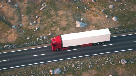 osiemnastka : Aerial shot of a semi truck driving on a highway into the sunset. Realistic high quality 3d animation.