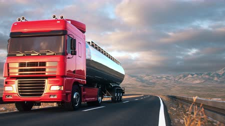 benzin : A tank truck passes the camera driving on a highway into the sunset, low angle front-view camera. Realistic high quality 3d animation. Stok Video