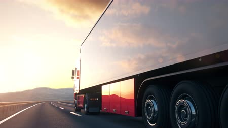 trucks : The camera follows a semi truck driving along a desert highway into the sunset. Low angle rear view camera. Realistic high quality 3d animation. Stock Footage