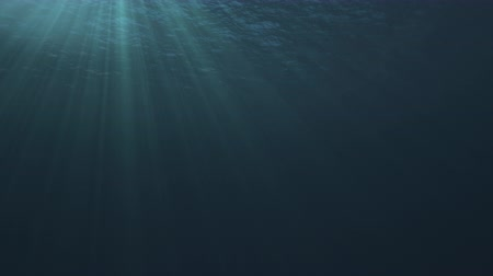 Seamless loop of a tranquil underwater scene with ocean waves and sun and light rays shining through - high quality 3d animation 影像素材