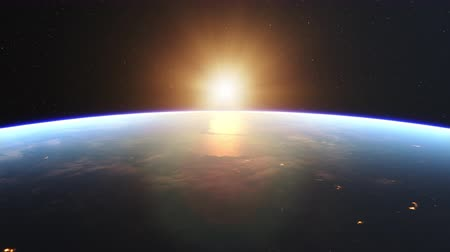 napsütéses napon : 4K Beautiful Sunrise over Earth. Realistic earth with night lights from space. High quality 3d animation. Stock mozgókép