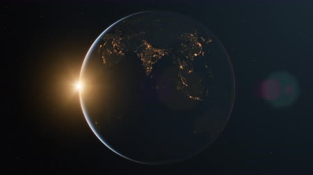 4K Slowly rotating realistic earth from space. Dark side with night lights. With Sun and lens flare. Seamless looping. High quality 3d animation.