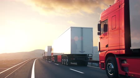 ciężarówka : A convoy of semi trucks drives passed the camera on a highway into the sunset. Realistic high quality 3d animation.