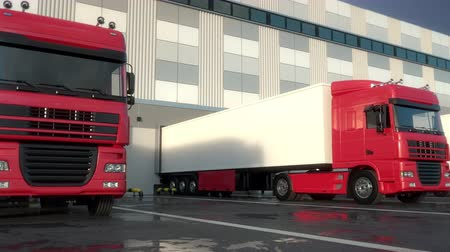 Red semi trucks loading and unloading goods at warehouse dock. Low parallel tracking shot. Seamless loop. Realistic high quality 3d animation. Stock Footage