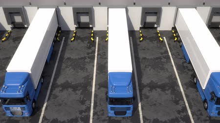 v řadě : Blue semi trucks loading and unloading goods at warehouse dock. Aerial view tracking shot. Seamless loop. Realistic high quality 3d animation.