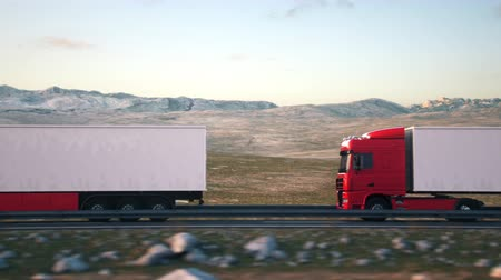 Side-view camera passes a convoy of semi trucks driving along a desert highway into the sunset. Realistic high quality 3d animation.