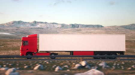 The camera follows a semi truck driving along a desert highway into the sunset. Low angle rear view camera. Realistic high quality 3d animation. Stock Footage