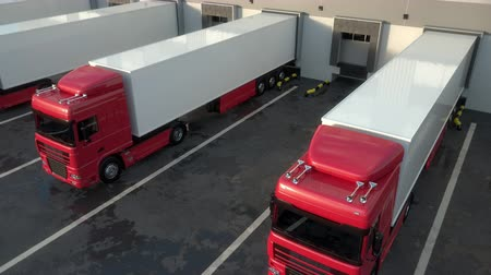 visão global : Red semi trucks loading and unloading goods at warehouse dock. Low parallel tracking shot. Seamless loop. Realistic high quality 3d animation. Stock Footage
