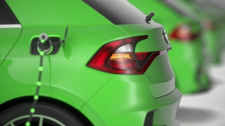 Close up dolly shot along green electric cars charging. Shallow depth of field. Focus on charging plug. Seamless loop. 4K. Alternative energy and ecology concept. Realistic high quality 3d animation. Stock Footage