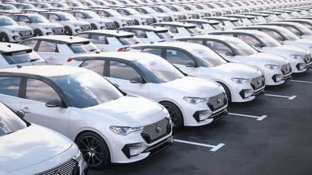 Tracking shot along rows of new electric self driving cars on car on big storage parking lot. New electric cars for sale at car dealership parking lot. Realistic high quality 3d animation.