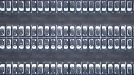 self storage : Aerial view of new electric self driving cars on car on a huge car dealership parking lot.  Multiple rows of electric cars for sale. Seamless loop. Realistic high quality 3d animation.