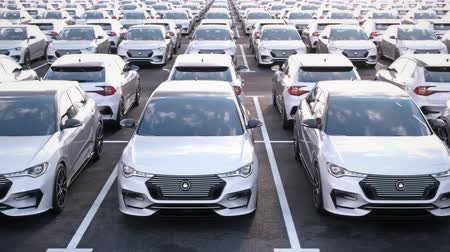 mobilitás : Front view of generic electric self driving cars on car on a huge car dealership parking lot.  Multiple rows of electric cars for sale. Seamless loop. Realistic high quality 3d animation.