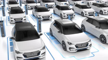 indústria : Top view of white electric self driving cars charging at charging station on white background. Alternative energy and ecology concept. Seamless looping realistic high quality 3d animation. Vídeos