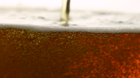 dark : Close up background of pouring sparkling cola soda water with bubbles or dark lager beer in glass, low angle side view, slow motion Stock Footage