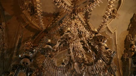 crypt : Low angle view tilt of human skulls and bones decoration of Kostnice, The Sedlec Ossuary near Kutna Hora in Czech Republic