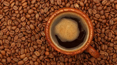 frothy : Close up one wooden cup full of Turkish black coffee over background of roasted coffee beans with slow motion animated cinemagraph spin of coffee froth, elevated top view, directly above Stock Footage