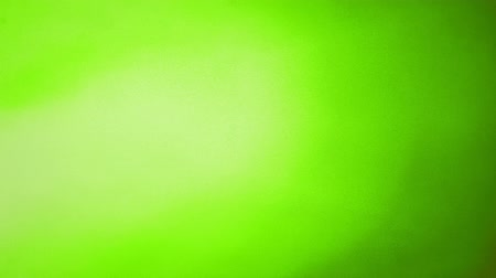 Animated loopable 4K abstract colorful background with grunge noise texture and light green color gradient Vídeos