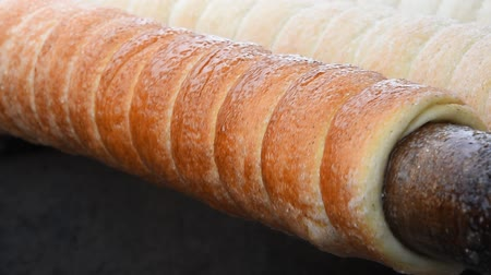 shovívavost : Close up sweet Trdelnik baking on grill and rolling this spit cake is popular in Europe Austria Hungary Slovakia and Czech especially in Prague