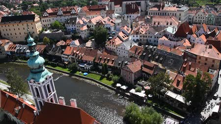 High angle aerial summer day view historical old town of Cesky Krumlow with cathedral tower over Vltava river Czech Republic