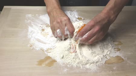 испечь : Mixing ingredients for sweet dough - flour, sugar, egg yolks, butter and tangerine juice
