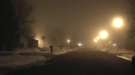 low lighting : Still residential street at night with thick fog hovering down on area. Stock Footage