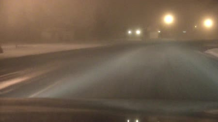 жесткий : Driving through residential streets on a foggy winter night with low beam and then high beams turned on for effect.