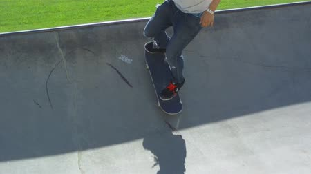 skate : Skateboarder attempting trick unsuccessfully at skate park in sunshine.