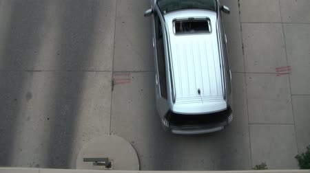 garagem : Clip of cars exiting parking garage in afternoon, shot from above looking down. Stock Footage