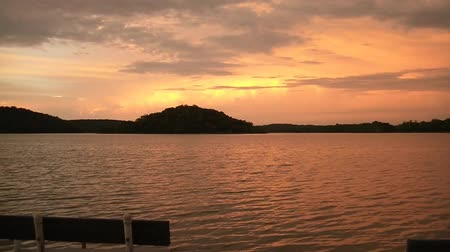 estético : Water and sky clip with extremely exotic orange and yellow colors at sunrise over a exquisite Minnesota lake.
