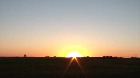 sustain : Sunset time-lapse over farm field during the heart of summer with lovely colors abound. Stock Footage