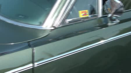 espetacular : Pan from rear to front of dark green muscle car from the 1960s era. Stock Footage