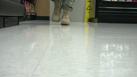 enlisted : Military personnel wearing boots that approach camera with slow and deliberate walk until fully close up. Stock Footage