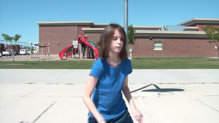 versenyképes : Girl dribbles basketball in sun towards camera, holds her position for a moment, and then cruises by at end.