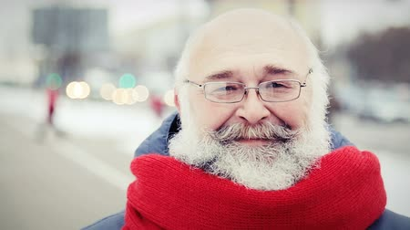 broda : Portrait of Happy Old Man with Beard in Winter Outdoors. Modern Mature Man Looking at Camera and Smiling. Senior Portrait. City Street Blurred Background.