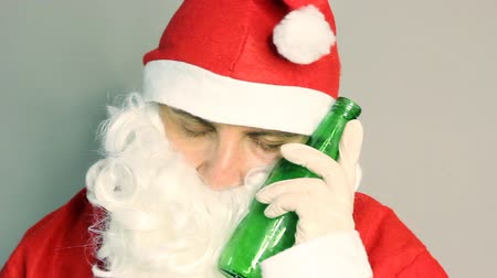 ing : Drunken santa claus sleeping with beer in hand