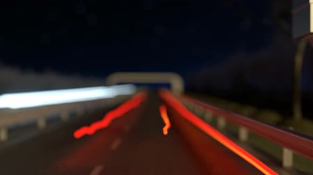 multa : moving light streaks on the highway next to the flashing radar street trap