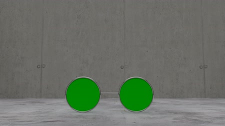 vestindo : Green screen sun glasses laying on concrete floor