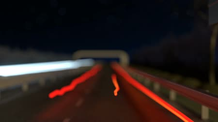 policista : moving light streaks on the highway next to the flashing radar street trap