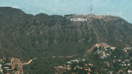 jel : Aerial view flying from East to West passing the Hollywood sign and the Hollywood hills in Los Angeles.