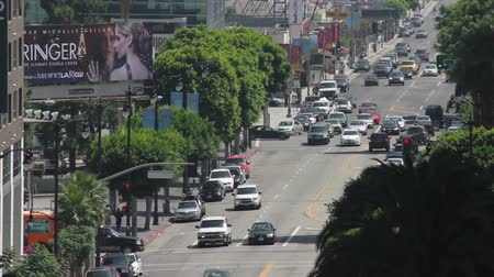 mais : Extreme long shot looking South on Vine Street towards Hollywood Boulevard in Los Angeles, California. Visible off in the distance is vehicle and pedestrian traffic.