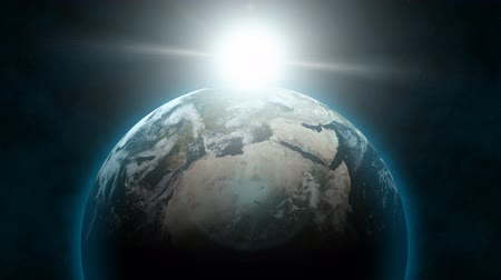 dönen : From outer space, planet Earth rotates with a blue atmospheric glow as the sun rises behind it.  The clouds in the Earths atmosphere are also animated.  Also available in:  [link]stock-footage290926 [item]290926 iconsres[item][link] 25fps for PAL  [l