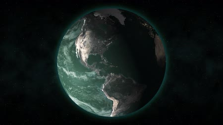 solar : From outer space, the camera pushes in on Earth as it rotates with a greenish tint.  Stock Footage